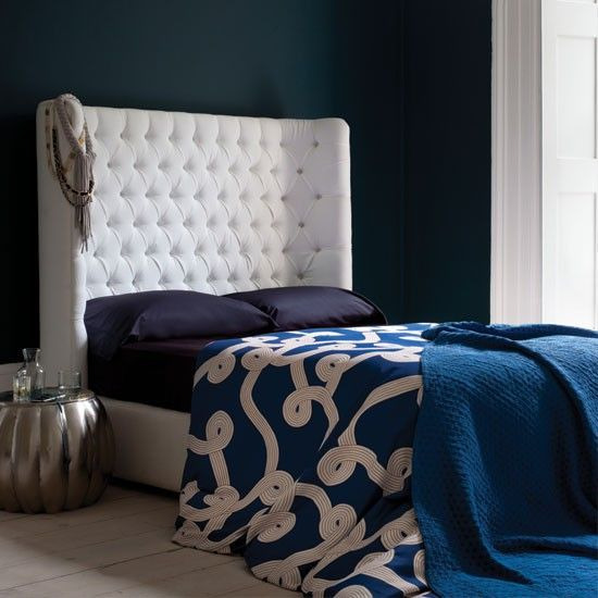 Like the dramatic blue-white contrast and the headboard.