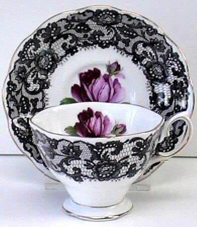A purple rose? Cool. A purple rose and black lace? Awesome. A purple rose and black lace detailed tea cup and saucer set? Bliss. Now all it needs is tea.