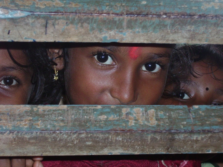 My favorite picture of all time. Three Indian girls having fun at their school and I was taking pictures through the fence.