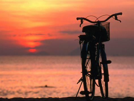 Bicycle Silhouetted Against Sunset on Nha Trang Beach, Nha Trang, Khanh Hoa, Vietnam Photographic Print by John Banagan at Art.com