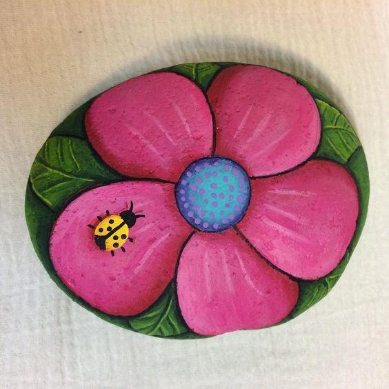 #Flower n #Ladybug #paintedrocks #rockinart58