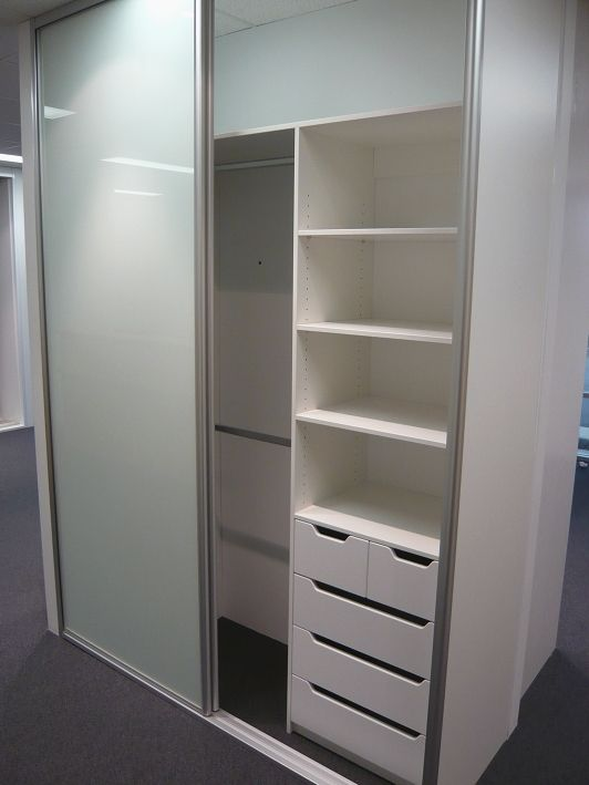 Floor to ceiling, 2 door Optipanel sliding door wardrobe, draw /shelf unit with split drawers