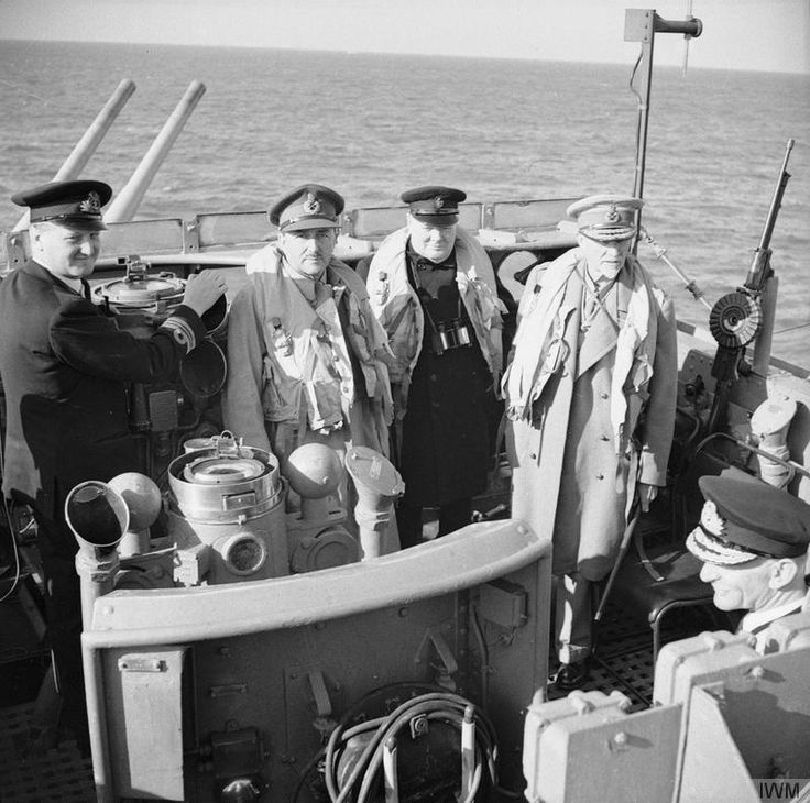 Winston Churchill with Field Marshal Jan Smuts, of the Imperial War Cabinet, (right) and Field Marshal Sir Alan Brooke, CIGS (Chief of the Imperial General Staff), on board the destroyer conveying his party to Normandy, 12 June 1944.