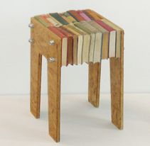 Book side table: He had a similar idea for a coffee table but I'm digging this one