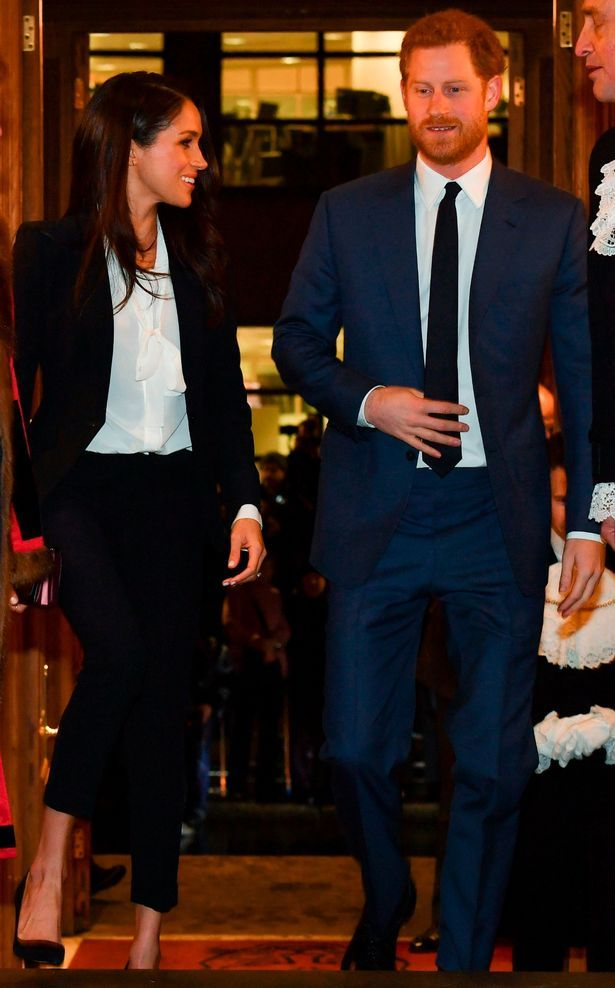 The former Suits actress defied expectations by arriving in a smart trouser suit for her first evening engagement with Prince Harry on Thursday night