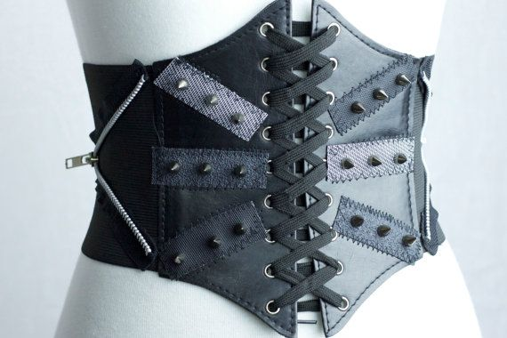 High fashion, warrior tough. Our Spiked Waist Cincher is that extra something that your wardrobe has been craving. It features two decorative