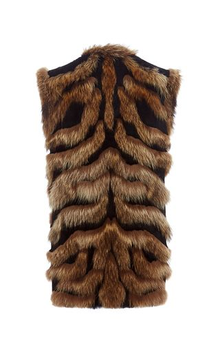 Rendered in a mix of Marmot and Lapin fur, this **Alberta Ferretti** vest features a collarless design, an allover animal striped texture, and an oversized fit.