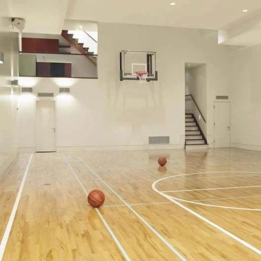 Basketball court inside the house how awesome would for Indoor basketball court installation