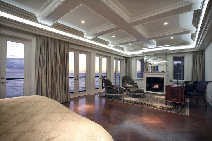MC: ditch the mirrors (quelle horreur!), keep or ditch the ceiling, change de or style; love the doors/windows, make them open on a huge terrace, and love the extended part of the room with a fireplace and reading/relaxing area. - Luxury Master Bedroom Designs from @hgsphere