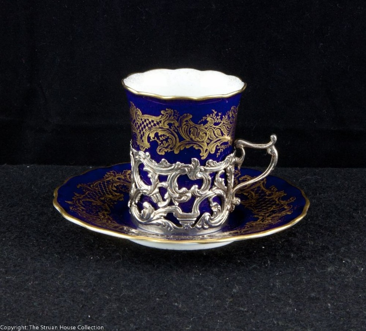 A stunning cobalt blue Coalport coffee cup and saucer in a hallmarked silver holder The silver holder was made by the Goldsmiths Silversmiths Company (Garrards) in 1912.