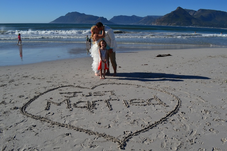 Just married drawn onto the beach