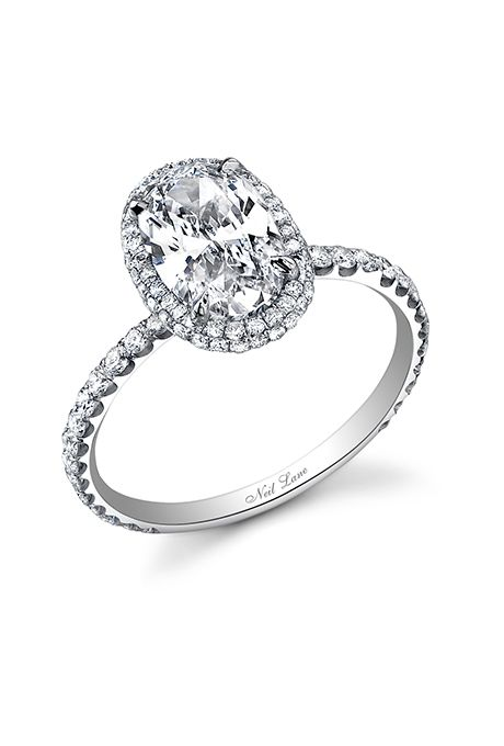 Brides.com: . Oval diamond ring accented by a rolled diamond halo handcrafted in platinum, price upon request, Neil Lane