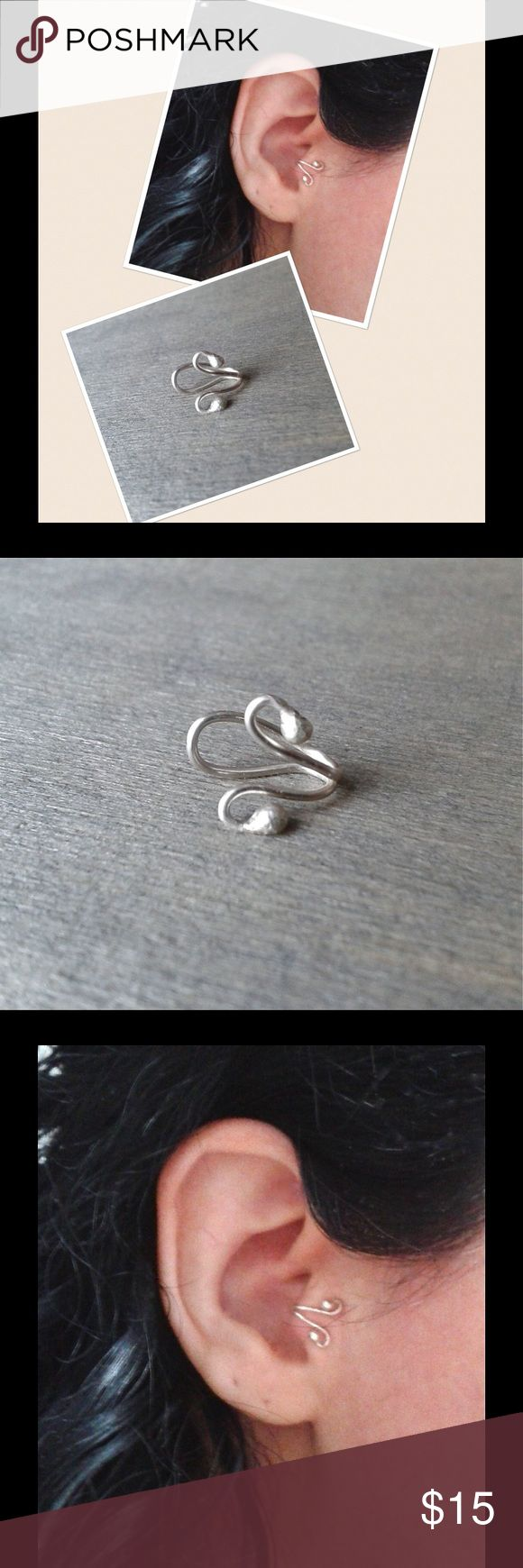 999 Sterling silver Tragus Cuff A cute, trendy little swirly ball End Travis Cuff made of fine .999 Sterling silver. ⭐️NOTE⭐️ Fine 999 Sterling silver is 99.9% pure silver while 925 Sterling silver is only 92.5% silver. Completely hypoallergenic and nickel free. Comes gift boxed ready for gift giving. nejd Jewelry Earrings