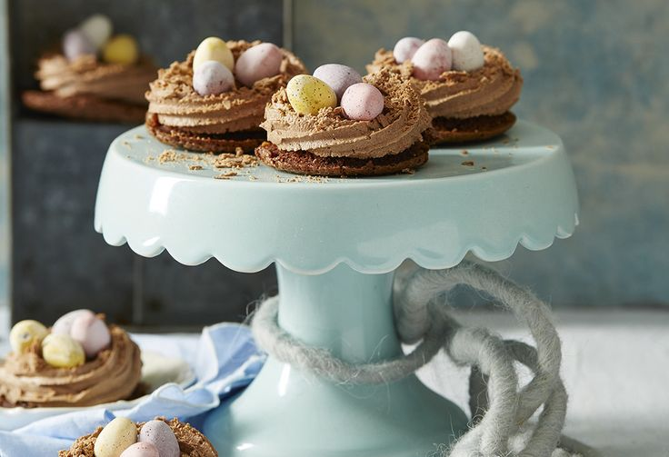 These Easter cakes will get you in the Easter mood! Topped with a creamy, chocolate buttercream and mini choc eggs, they're so little, you may as well have two!