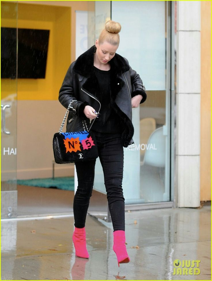 http://www.justjared.com/photo-gallery/3254247/iggy-azalea-removes-asap-rocky-tattoo-17/