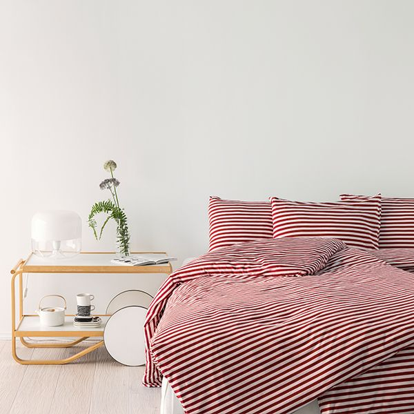 Tasaraita duvet cover features one of Marimekko's signature prints, designed by Annika Rimala. The red and white stripes form a delightful, graphic pattern that suits both traditional and contemporary bedrooms.