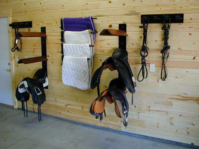 Simple and organized tack room. Just need some cabinets or something for grooming supplies.