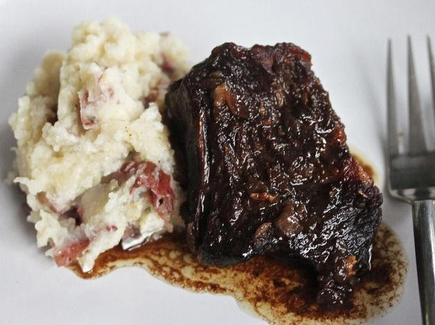 Short ribs braise in a red wine, balsamic vinegar and brown sugar sauce before they're served atop garlic mashed potatoes.