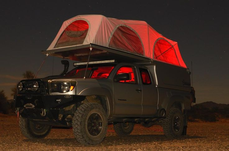 2006 Tacoma with a Flippac camper shell on the back. I love the concept! Check out 'Barlowrs Expedition Tacoma Build' thread on ExpeditionPortal.com for more details of his build!