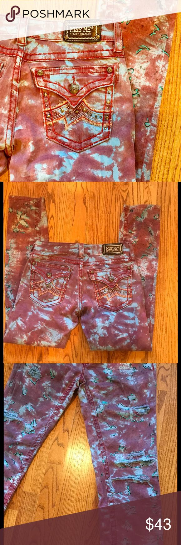 Miss Me Unique Tie Dye Jeans Stylish one-of-a-kind Miss Me decorated pants. They are tie dye design and are decorated with bling around the front and back pockets. They have front rips on both legs. They are decorated with puff paint and splashed paint that is very faint. Size 30. Color is red tie dye and they are a 32 inseam. Miss Me Jeans