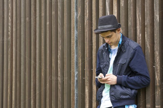 young man with smartphone by pruden.alvarez on @creativemarket