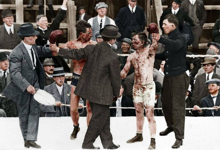 A colorized photo of the aftermath of a 1920's boxing match.