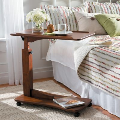 Use the Adjustable Bedside Table for eating, working on your laptop, and more. This stylish bedside table telescopes from 32H to 42H.