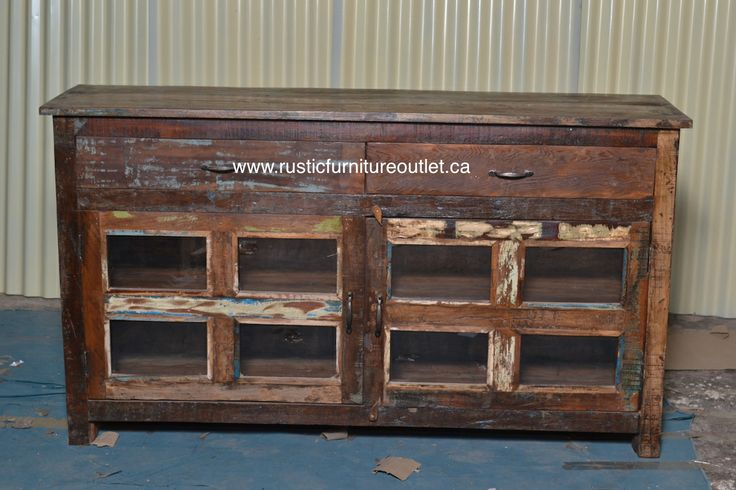 """Crafted from recycled wood solids in a multi-colored hand-painted finish ensuring bonafide originality, this TV stand or side board offers the faded colors of an heirloom as well as an alluring rustic charm.  dimensions: 59""""L x 33""""H x 16"""" D  cOST 479$"""