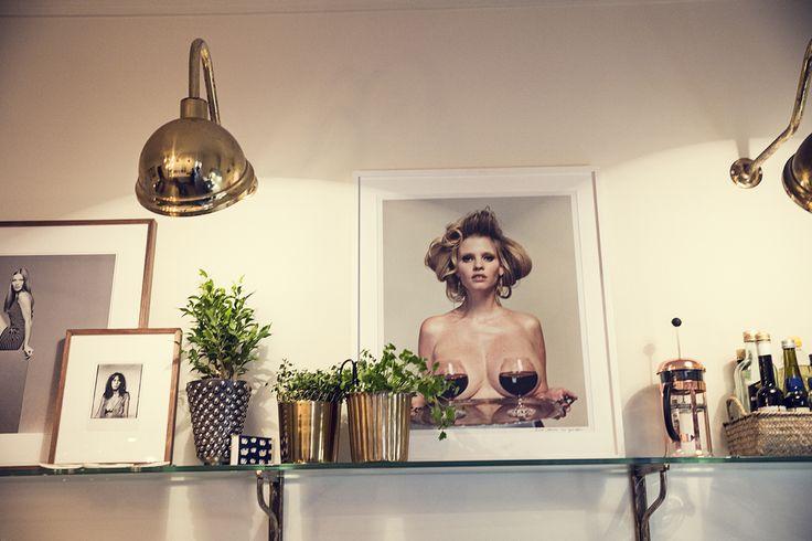 The Way We Play Magazine - Dusty Deco founder Edin Memic Kjellvertz - Kitchen with photo art, brass lamp, greens..