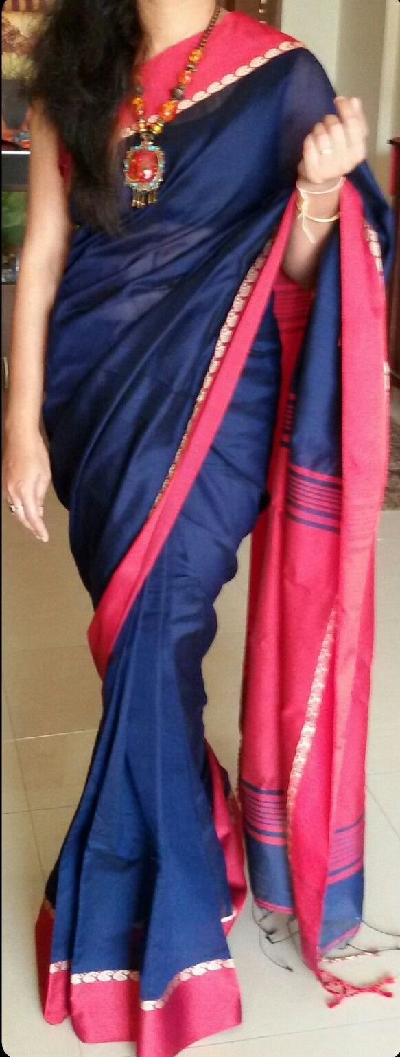 Royal blue with red border on both sides and red pallu.