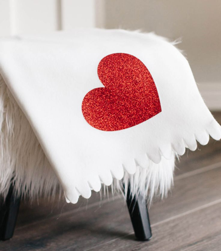 Make A Glitter Heart Blanket to snuggle up with your special someone  on Valentine's Day. Pick your fleece and your Glitter heat transfer vinyl.