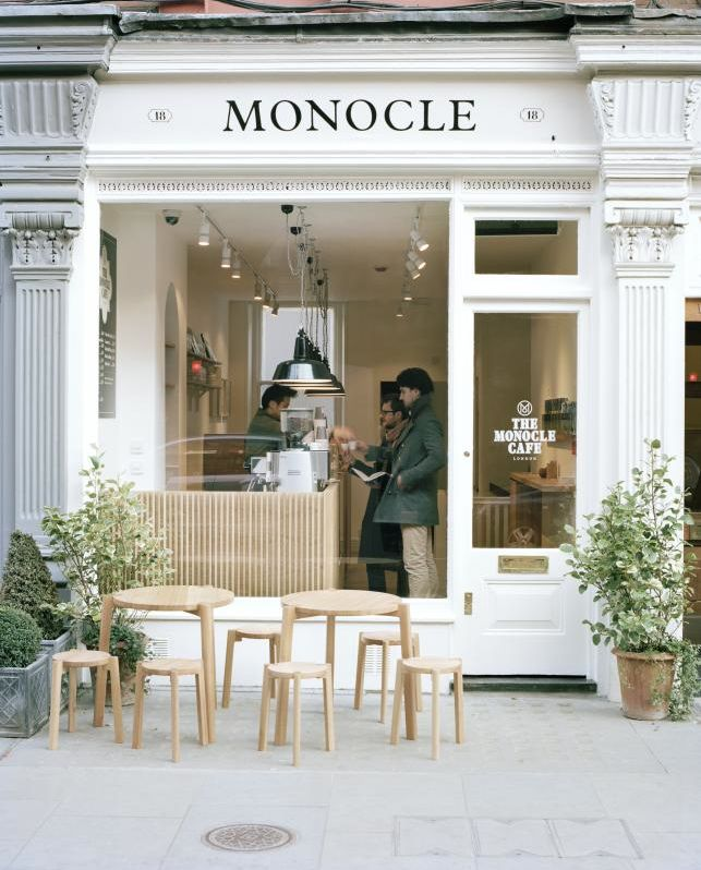 Monocle Cafe, white, bit of black and greenery  - classic, sophisticated, clean