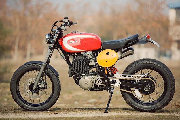 Not a fan of the number plate/heat shield in yellow, or the kitschy Rad written on the tank, but I love me a monoshock enduro converted into a scrambler.