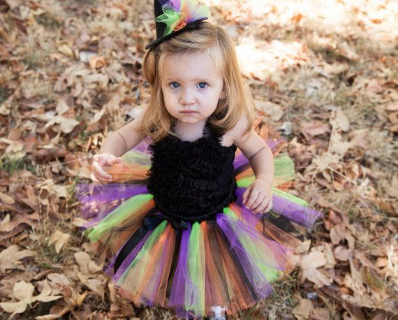 TutuDoll.coms adorable Witch Tutu Costume is the perfect costume for your little one! This listing includes the tutu and mini witch hat. The black