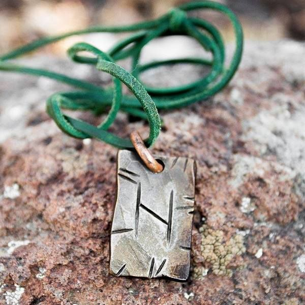 These are extremely popular! A lot of people love these fun Norse pendants with the Norse alphabet on them. We have conveniently added a hole and copper ring to