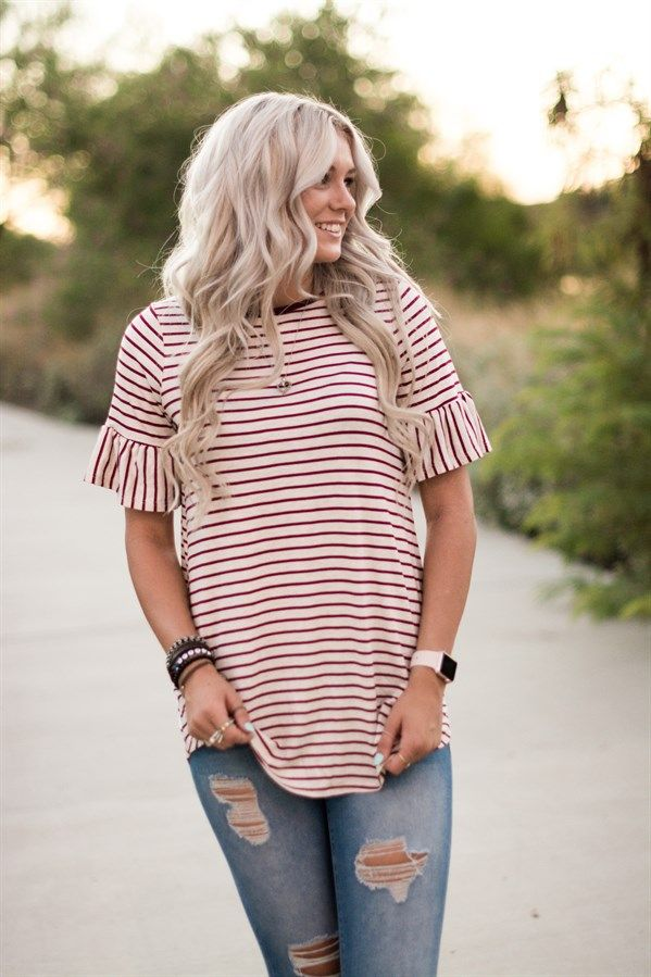 This is our new go-to tunic! This versatile piece is a must-have for every woman's wardrobe! The classic bell sleeves are feminine and on-trend.