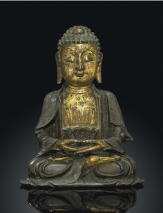 A GILT BRONZE FIGURE OF BUDDHA - MING DYNASTY, 17TH CENTURY