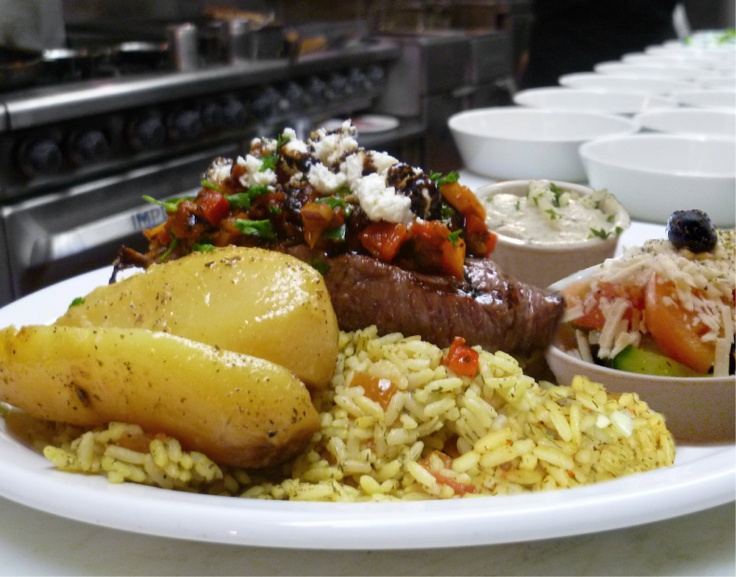 8oz. AAA Canadian striploin, California cut seasoned with house spice & topped with a Mediterranean salsa; including goat cheese, tomatoes, fresh herbs & a balsamic reduction drizzle. Served with rice, and/or potato, Greek salad, tzatziki & freshly baked bread with olive oil/balsamic vinegar for dipping. $18