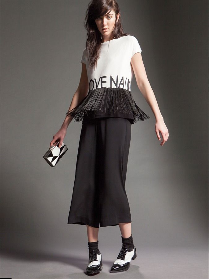 """Model wears Naughty Dog FW15 soft """"love Naughty"""" stretch viscose shirt decorated with fringes and a matching piar of midi pants"""