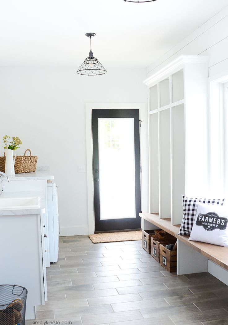 A Charming Farmhouse Laundry Room And Mudroom Featuring Shiplap Walls White Paint DIY