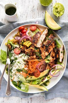 A giant salad loaded with Hawaiian flavours! An incredible pineapple coconut marinated chicken, lots of greens and a cilantro lime dressing.