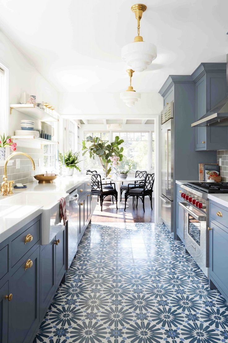 Galley Style Kitchen With Patterned Floor And Blue Cabinets