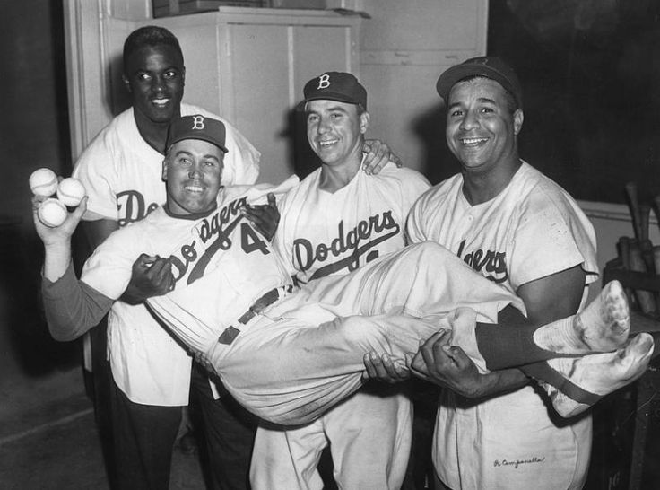 Duke Snider is carried by teammates Jackie Robinson, Pee Wee Reese and Roy Campanella of the Brooklyn Dodgers