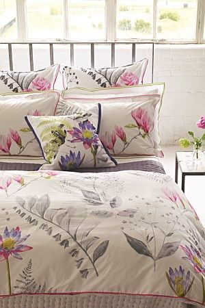 Delicate hand-painted fuchsia blooms counter-weigh the graphite stems and ferns of this gorgeous printed cotton bedding. Floral with an urban sophistication.