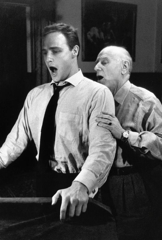 Marlon Brando practices with his singing coach for Guys and Dolls, 1955