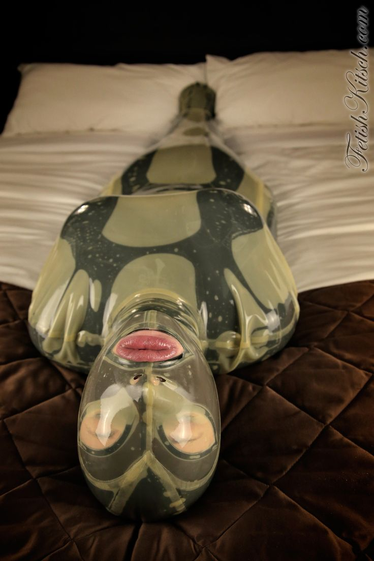 "A latex lovers wet dream come true. New update ""Cocooned"" up now on FetishKitsch.com   FYI: Those fetish perverts at Latex Nemesis have started making the most snug fitting latex body bags that you can customize with an attached hood, so you are completely encased. I loved the feeling of sliding into this tight fitting glove that perfectly skimmed my body. Not only was it perfectly fitted, but it had inside, to ensure I could not get out. With an attached eyeless hood, I was"