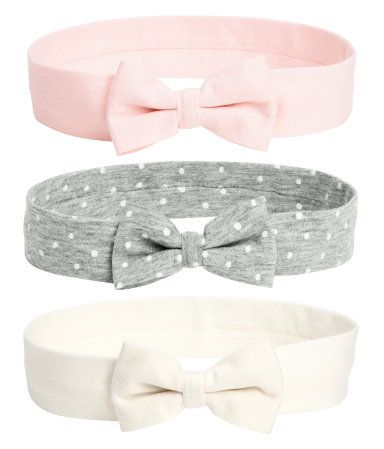 Hairbands in jersey with a decorative bow at front.