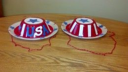 Another easy and fun craft for the kids. Patriotic hats made from a paper plate and a plastic hat. :-)