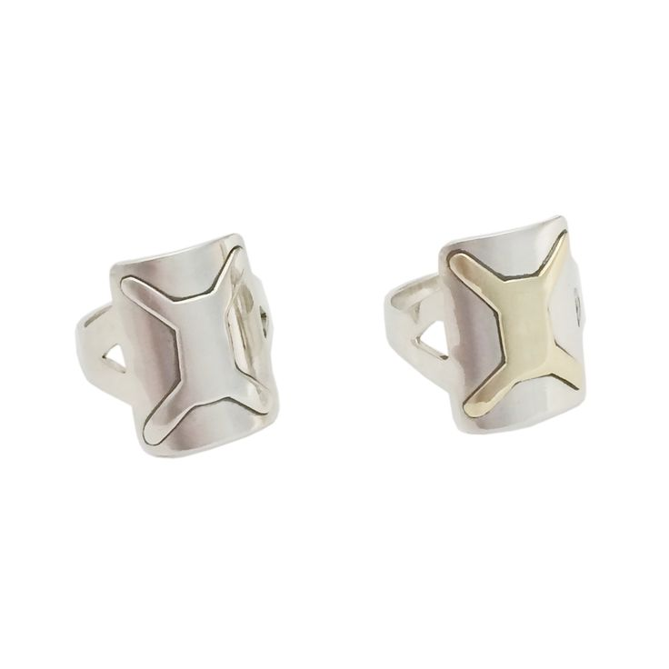 Handmade in sterling silver with a sterling silver or brass shield design.