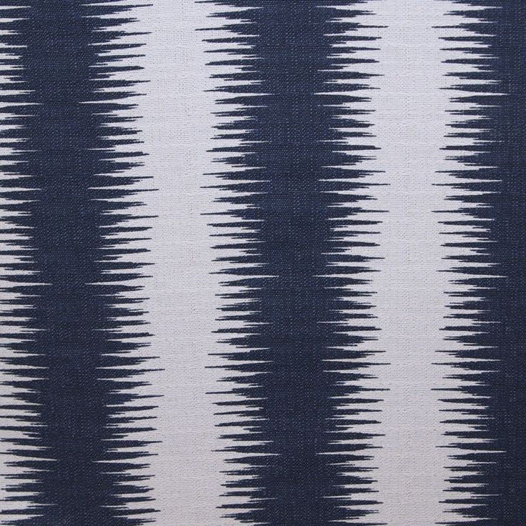An inspired-by tribal fabric with a southwestern, global feel. The pattern is medium scale in navy blue and creamy oatmeal. Fabric has a textured bark like weave.Suitable for drapery, curtains, roman blinds, decorative pillows, seat cushions, upholstery and other home decor accessories.Content: 100% Cotton canvasWidth: 54
